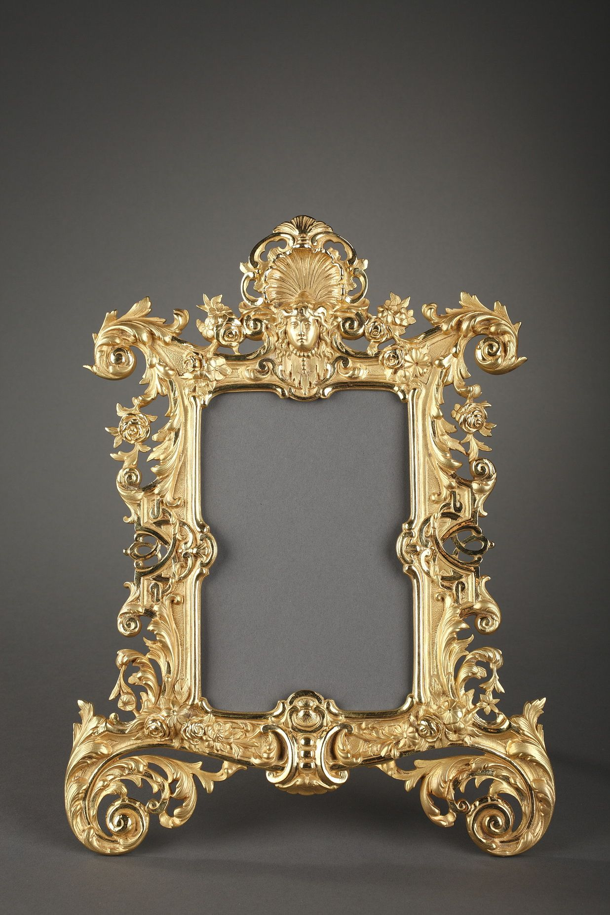 Gilt bronze frame richly sculpted with garlands of flowers, roses ...