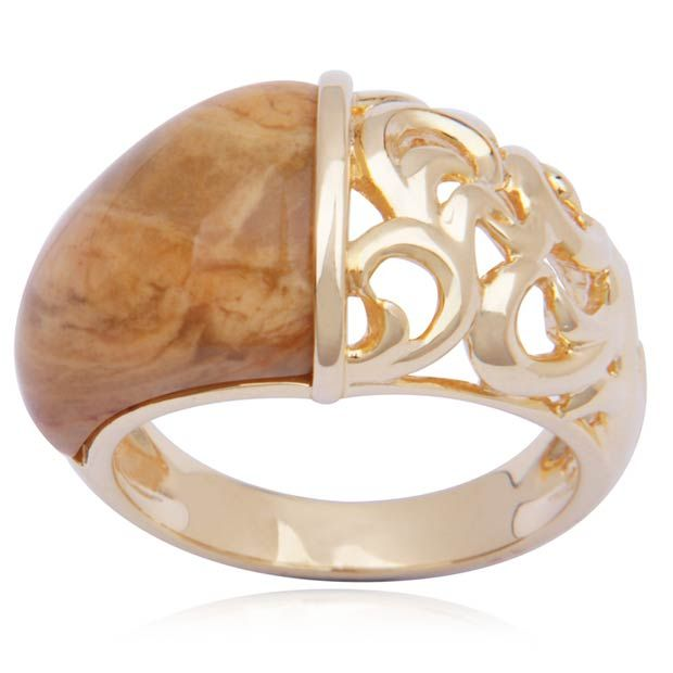 Exude a cool and confident style whenever you don this sophisticated ring. Gold over sterling silver is rendered into an alluring design that showcases two strikingly different motifs. One side uses the gleaming gold over sterling silver to create an intricate design of romantic scrollwork. The other side boasts a soothing cut of yellow agate creating a beautiful contrast that adds style to any look.