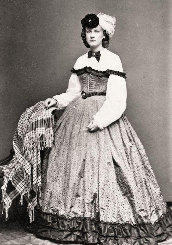 Lady with Swiss waist and plaid shawl, 1860s