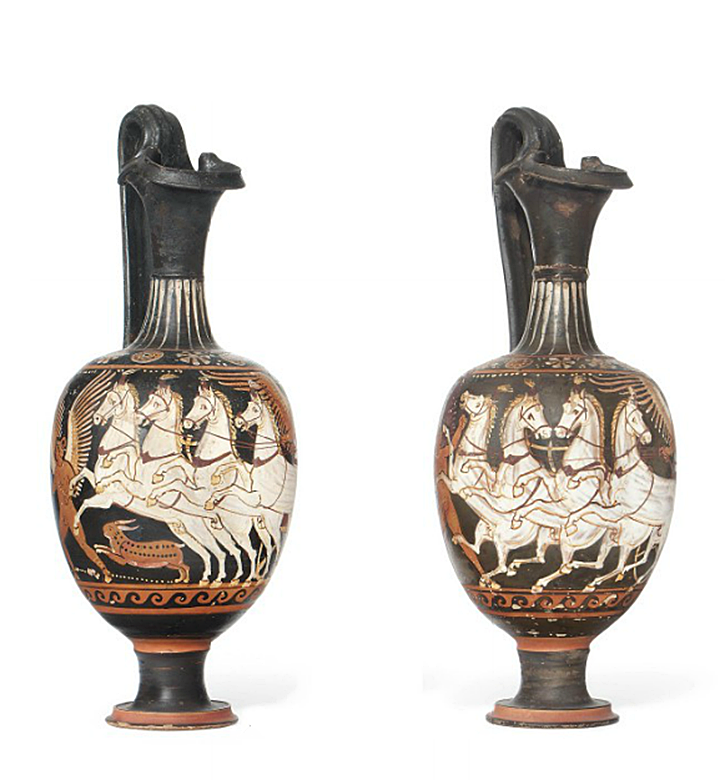 TWO APULIAN RED-FIGURED OINOCHOAI ATTRIBUTED TO THE PAINTER OF BERLIN F 3383, CIRCA 320-310 B.C. Both with trefoil lips, each decorated with a winged Nike driving a quadriga to the left, with rearing white horses, a running winged Eros in front, one with a running hare at the side, double scrolling palmettes under the handles, band of waves below, rosettes and dotted circles on the shoulders, rays on the neck, details in added white, red and yellow