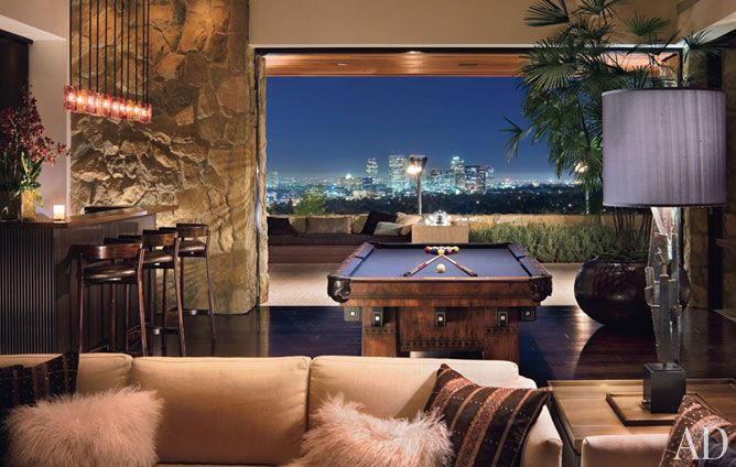 """Jennifer Aniston@home!  The game room, with its bar and vintage pool table, is """"a great hangout at parties,"""" . """"And there are lots of places to sit outside."""""""