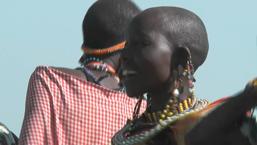 NAROK - JULY 12: Close up of Masai women dance and sing on July 12, 2010 in Narok, Kenya.