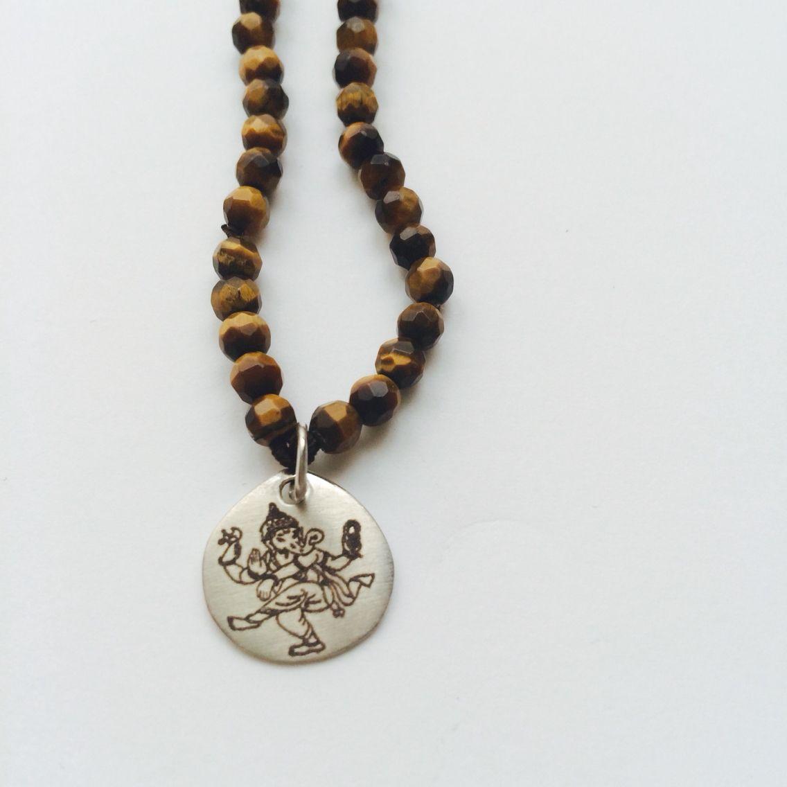 Collar Ganesha, plata y ojo de tigre.