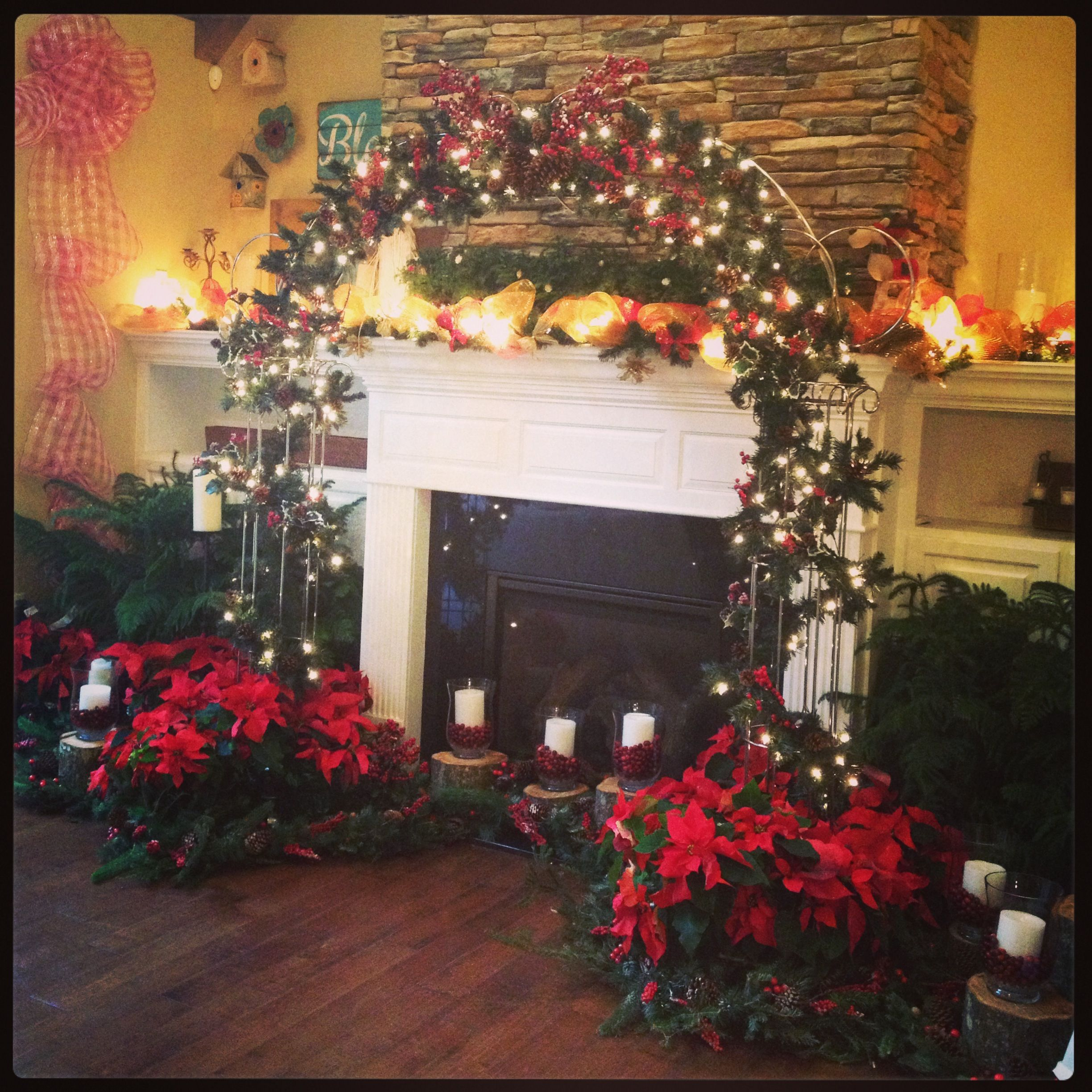Christmas Fireplace Wedding Arch Poinsettias Indoor Wedding