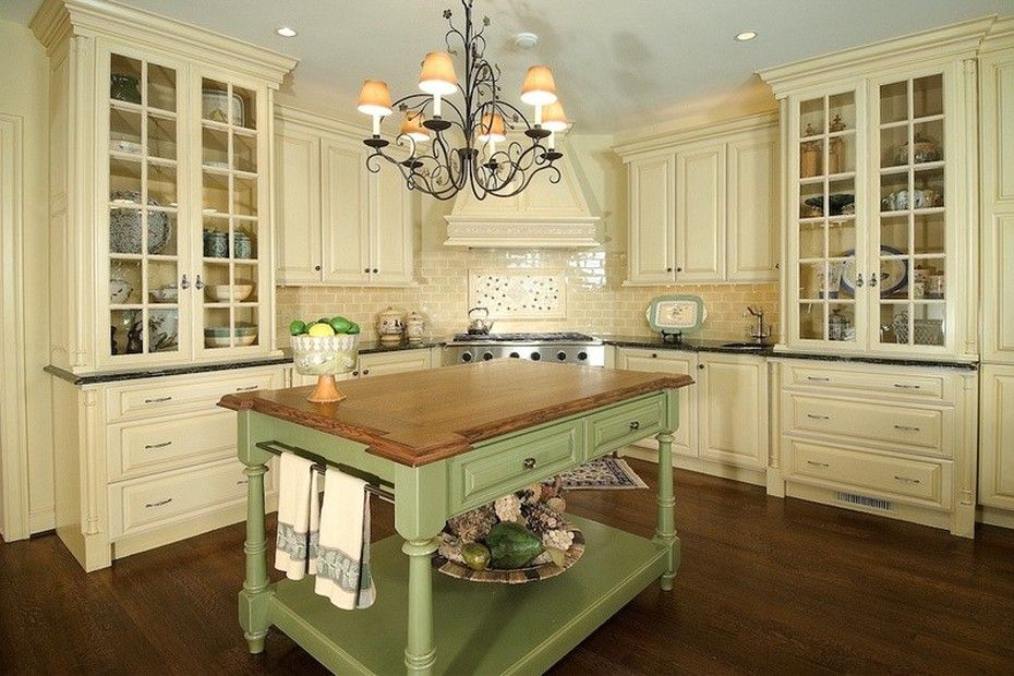 French Country style kitchen with cream cabinets and a wrought iron ...