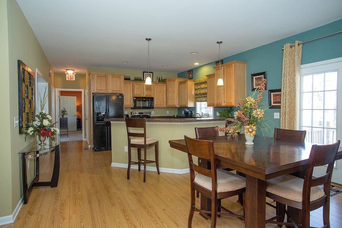 A view of the dining area with a kitchen nearby.