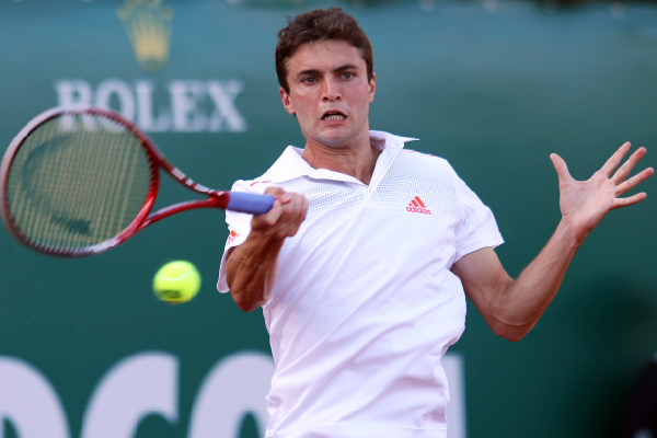France's Gilles Simon hits a return to France's Jo-Wilfried Tsonga during their Monte Carlo ATP Masters Series tournament tennis, on April 20, 2012 in Monaco.