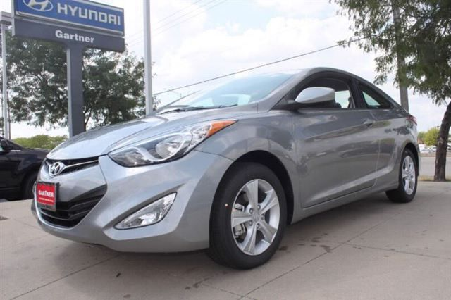 All new 2013 Hyundai Elantra Coupe in Titanium Gray Metallic.  Sporty, fun and sensible with an estimated 40 mpg's highway.