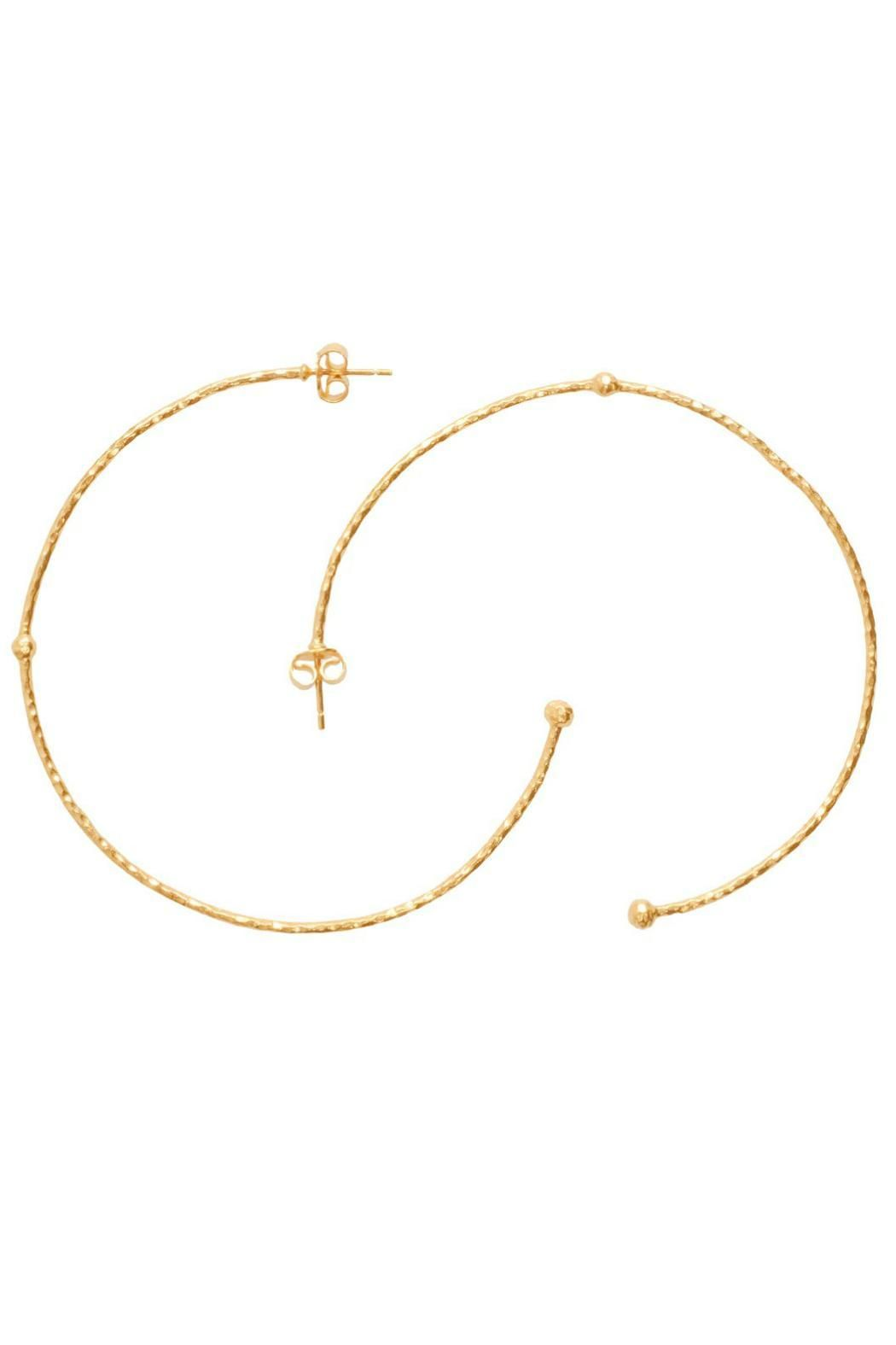 "Thin hammered hoop with a small ball detail at the end and another one in the center - lightweight versatile and easy to wear. 14K gold plated. Sterling Silver Backing.  Measurements: 2.5"" Diameter  Gold Hoop Earrings by Melinda Maria. Accessories - Jewelry - Earrings - Hoops Pennsylvania"