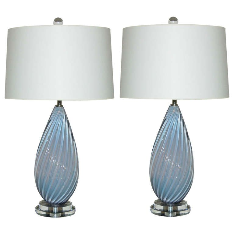 A perfectly matched pair of heavily ribbed lamps of SOFT LAVENDER, circa 1950's. The opaline blown into the glass gives the color a magical quality and depth.The lamps are 22 inches high from tabletop to socket top. As shown, the top of shade is 28 inches high. Lampshades are for display only and not available for sale.