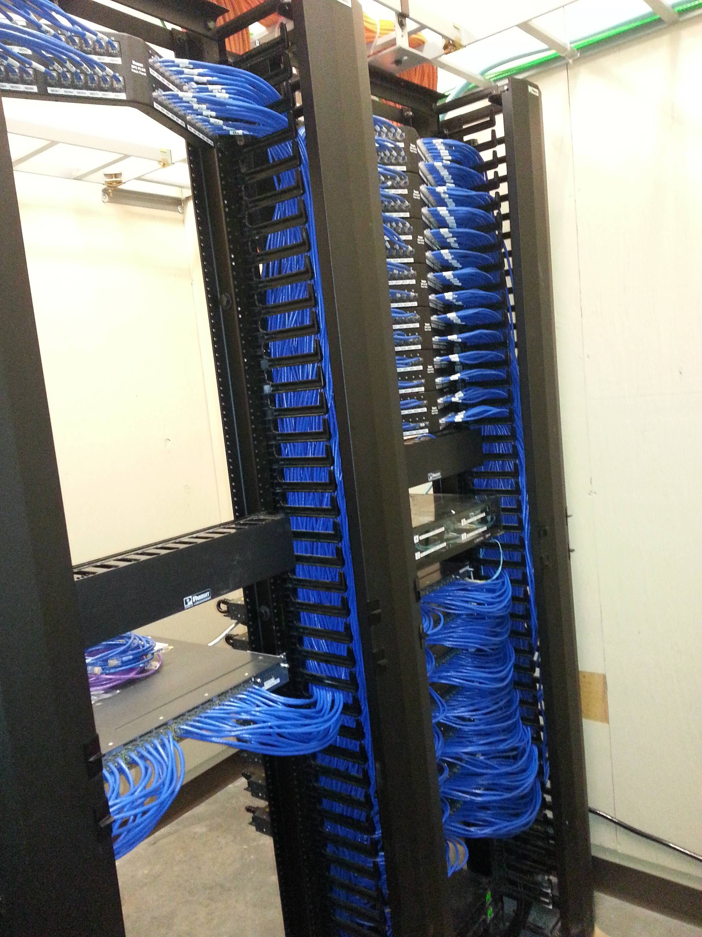 clean patch panel closet install. blue ethernet cables and patch