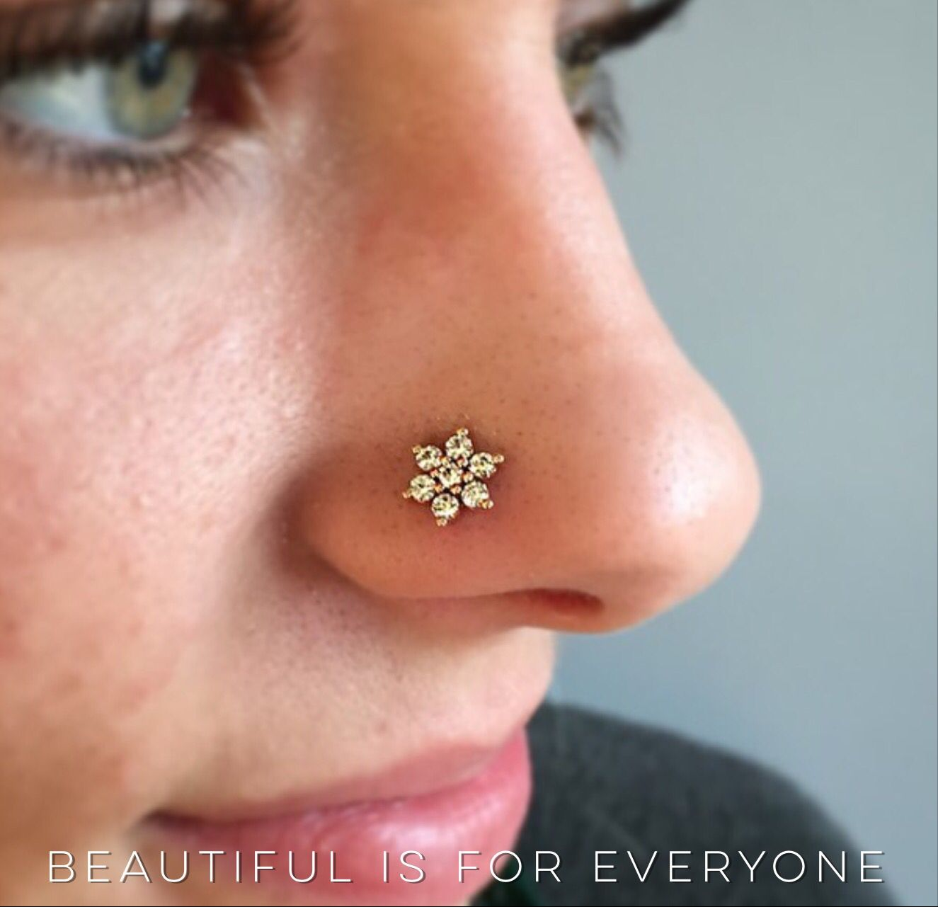 Upper nose piercing  We love this beautiful flower our client Piper picked out for her
