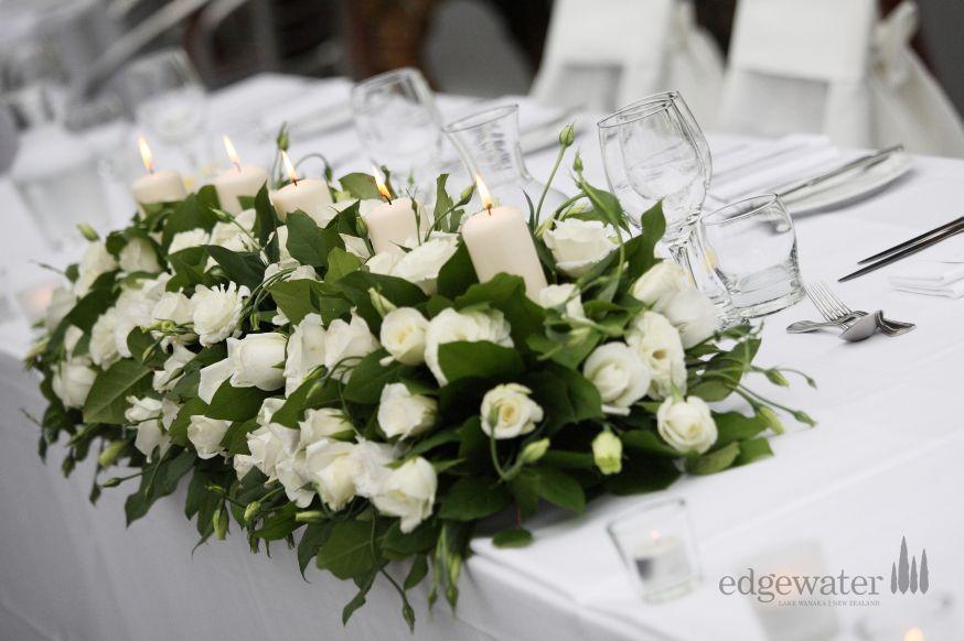 Simple and elegegant table decorations at Edgewater Lake Wanaka. http://www.edgewater.co.nz/resort/weddings/