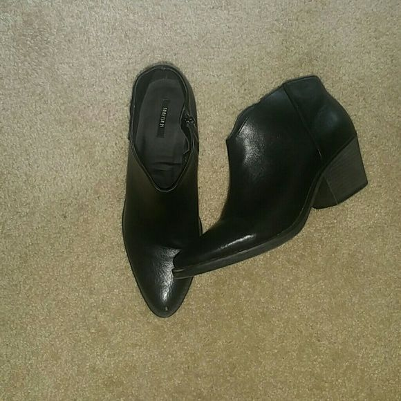 Black Boots Black Bootie. Forever 21. Size 9. Barely there scuff on the front of one. Heel is a rubber material and more of a dark smoke gray color. Not black like the boot. Worn only once. Forever 21 Shoes Ankle Boots & Booties