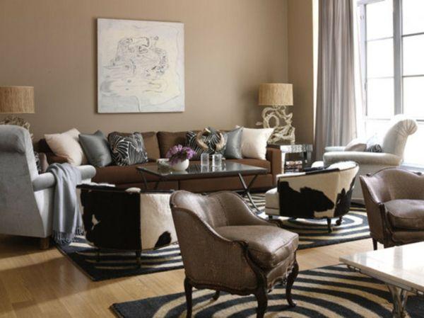 wandfarbe idee frs wohnzimmer ochra dekokissen braunes sofa sessel teppich gemlde an der wand - Welche Wandfarben Passen Zu Braunen Edlen Mbeln