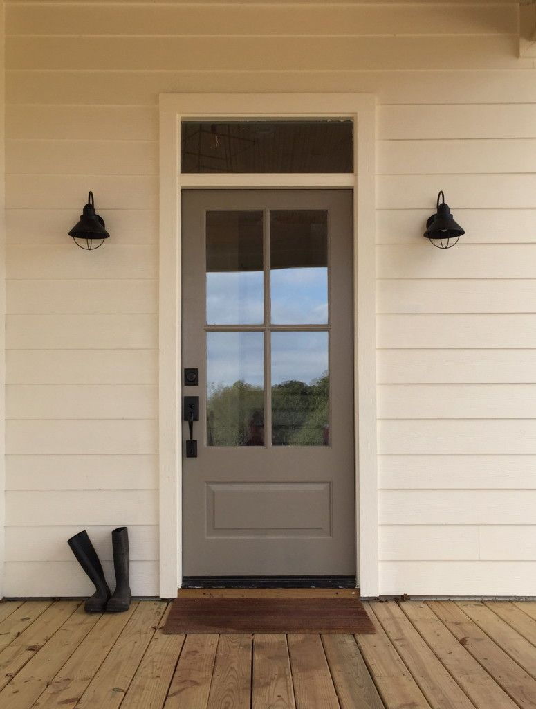 exterior door paint sherwin williams this door in elephant ear sw 9168 looks beautiful against the creamy exterior of this home while black hardware and light fixtures help to complete 27 best front door paint color ideas fabulous colors for
