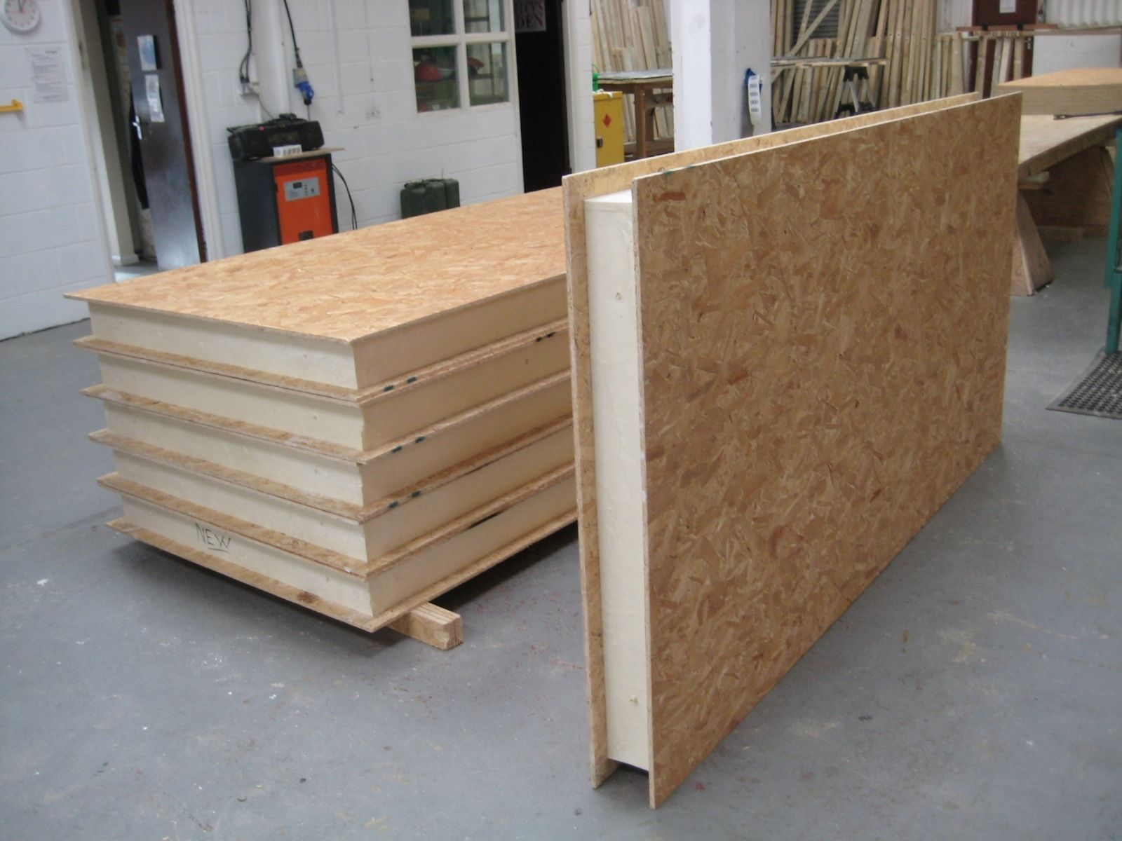 Structural insulated panels sips self build for garden for Insulated office