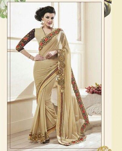 1. Light Beige Designer Lycra Dew Drop Sari 2. Comes with a matching unstitched Dupion Blouse