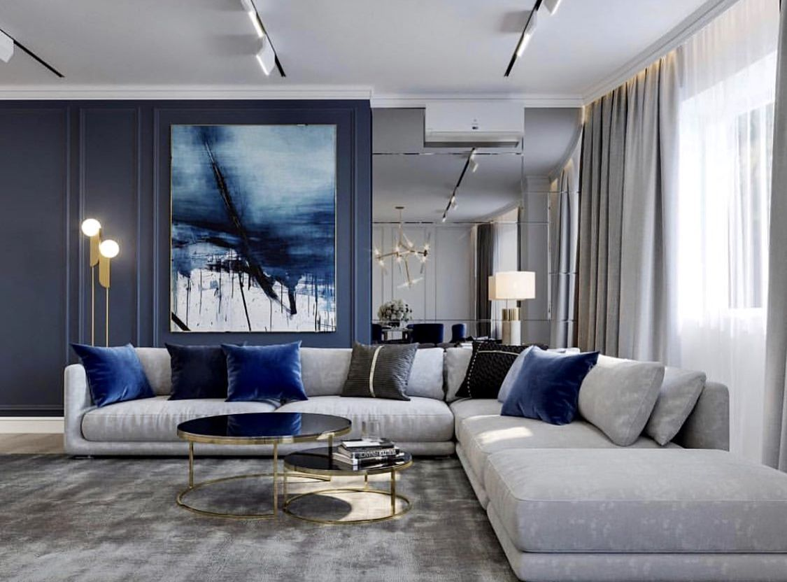Luxury Blue And Grey Living Room Decor With Blue Abstract Art Work And Grey Cozy Sectional Sofa Blue Living Room Decor Living Room Decor Gray Living Room Grey