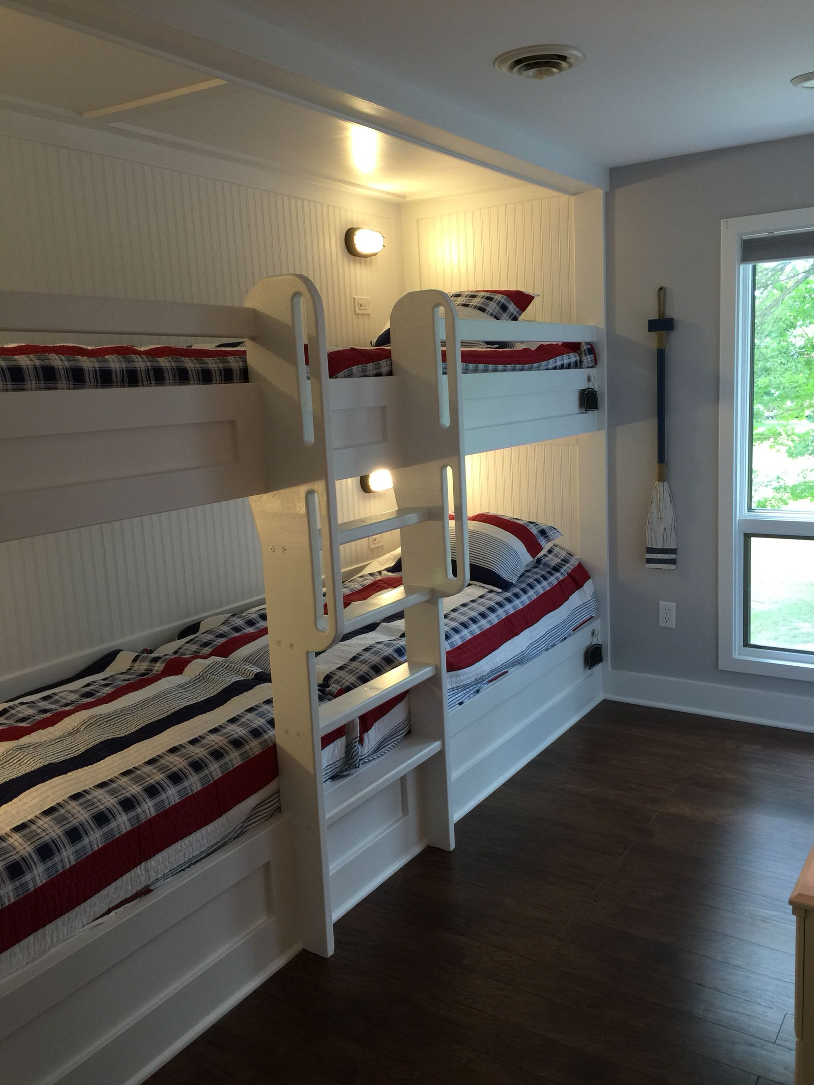 Double bunk beds with reading lights and USB charging port in each