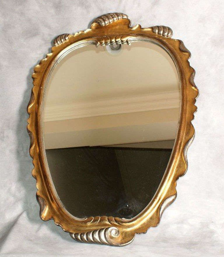 35x52 1450+ Italian carved gilt and silver gilt shell-form mirror | From a unique collection of antique and modern wall mirrors at http://www.1stdibs.com/furniture/mirrors/wall-mirrors/