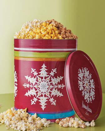 reuse empty christmas popcorn tins to store ornaments lights bows stack them for easy storage