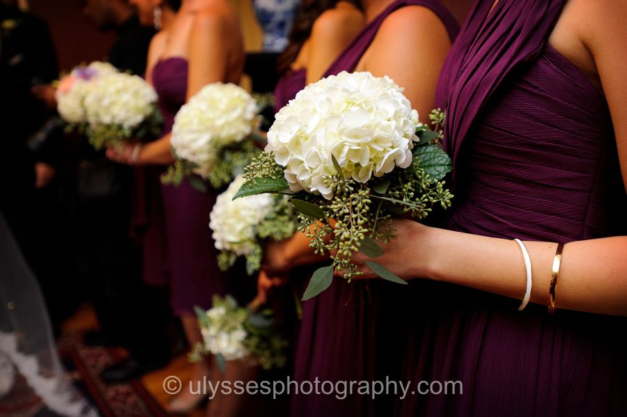 I'm thinking I like this color contrast of white bouquets against purple bridesmaid dresses!