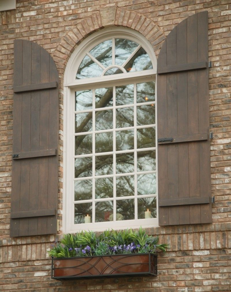 Arched board and batten exterior shutters in 2020