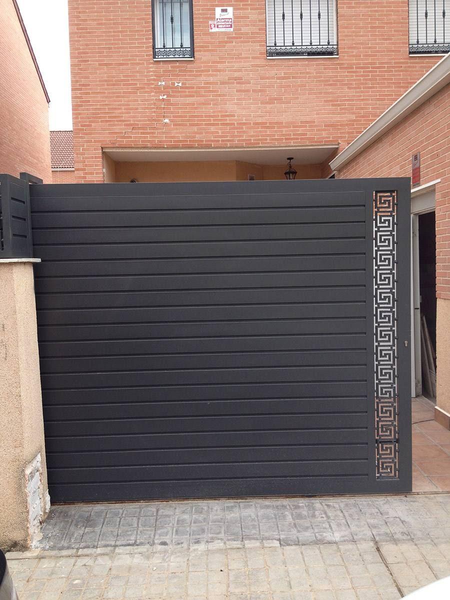 Puertas exteriores modernas imagenes portones de for Puertas de metal modernas exteriores