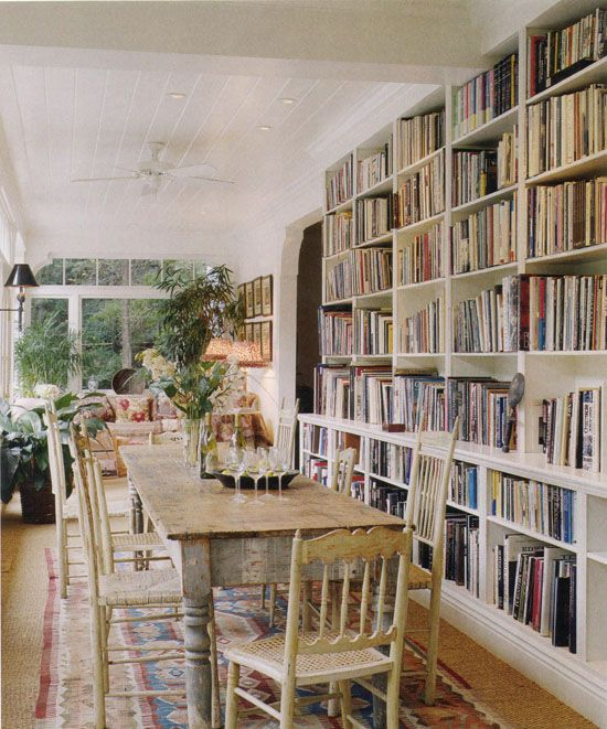 Now this, I LOVE! Books furnishing and decorating a room. Dining room? Study room? EITHER! Oh and look at all that light!