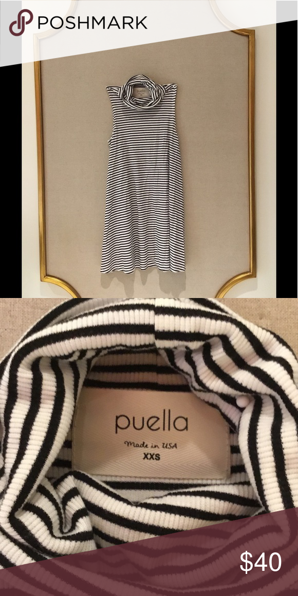 cfb6e29d3a2 Turtleneck Swing Tank (Worn once) This slightly used Pella black and white  striped turtleneck swing tank is a must have top! With it s bold pattern  and soft ...