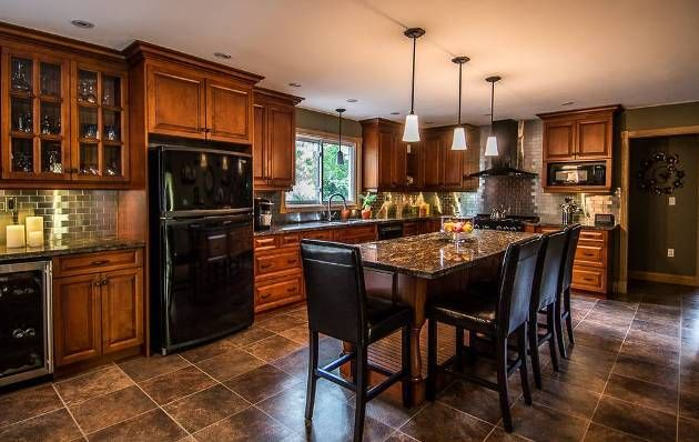 kitchen with black appliances and oak cabinets Best HOME