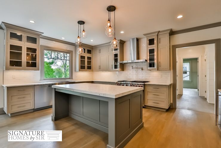 Fabulous custom kitchen features light gray shaker cabinets accented on kitchen ideas with window, kitchen ideas with tile floors, kitchen ideas with brick backsplash, kitchen ideas with breakfast bar, kitchen ideas with tile backsplash, kitchen ideas with black appliances, kitchen ideas with an island,