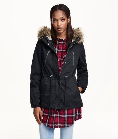 Short parka in woven cotton fabric. Lined hood with faux fur trim, zip and wind flap at front with concealed snap fasteners, chest pockets with zip, and side pockets. Drawstring at waist and hem, tab and snap fastener at cuffs, and vent at back. Pile lining.