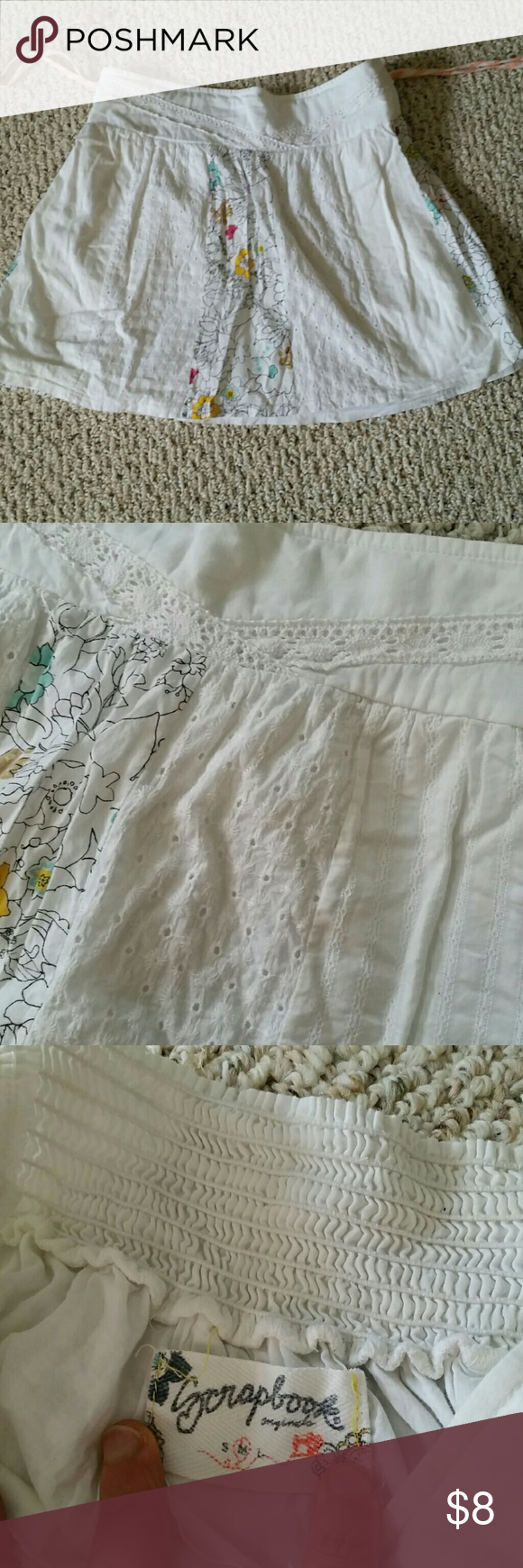 Cute little white skirt Little white skirt with a few different boho ish fabrics, back is wide elastic on top, side has tassles, floral fabric on front and sides as well scrapbook Skirts Mini
