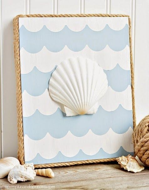 Cute DIY art with seashell on canvas that's rope wrapped. Featured on Completely Coastal: http://www.completely-coastal.com/2014/07/rope-picture-frame-gallery-wall.html