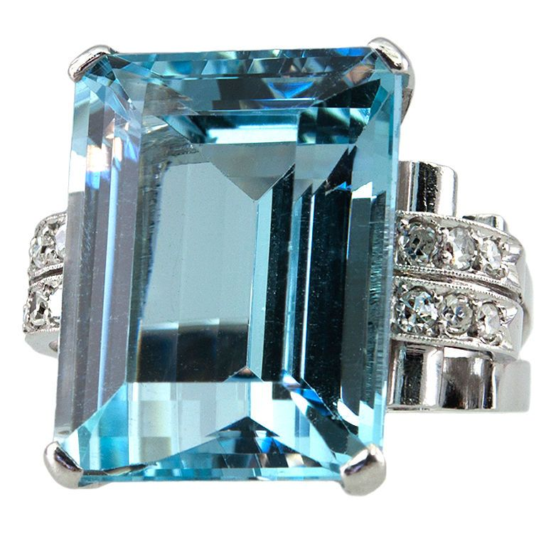 PAOLO BUFFA .Aquamarine Art Deco Ring. Very deco design mounting, with big shoulders that have two rows of single cut diamonds down the sides. The center holds an emerald cut Aquamarine of 13.5 carats. Circa 1930s