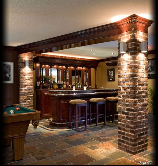 Cultured stone high desert used brick interior column bar for Interior columns design ideas