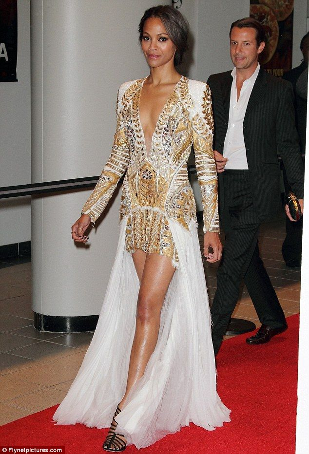 7a301713813 Turning heads  Zoe Saldana turned out to the premiere of her new movie  Colombiana in Miami last night in a stunning gladiator-style dress
