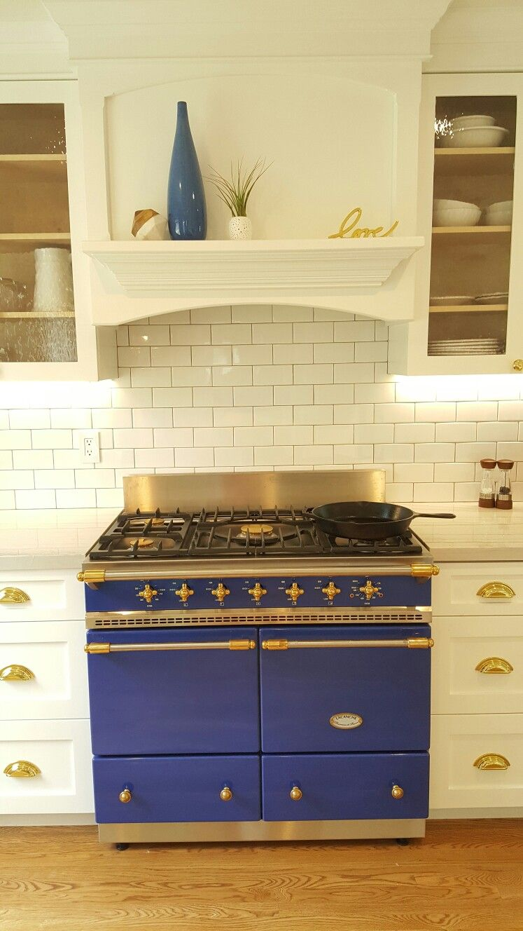 Lacanche Range Cluny White Shaker Kitchen Cabinets With Brass Hardware Glass Fron White Shaker Kitchen White Shaker Kitchen Cabinets Shaker Kitchen Cabinets