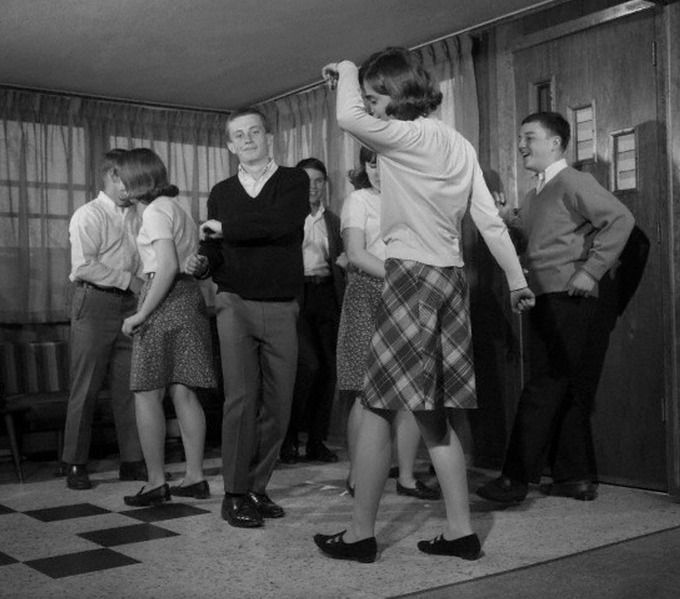 1960s Teens at a house party practicing the dance moves of the day
