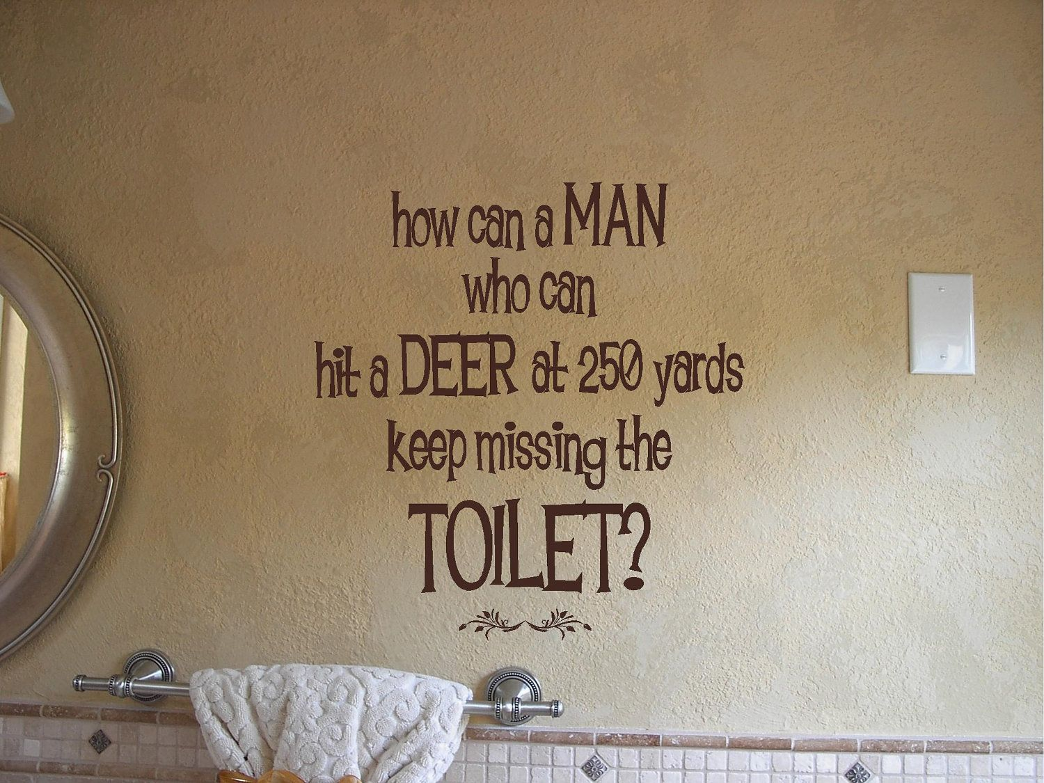 Bathroom hunting decor. How can a man who can hit a deer at 12