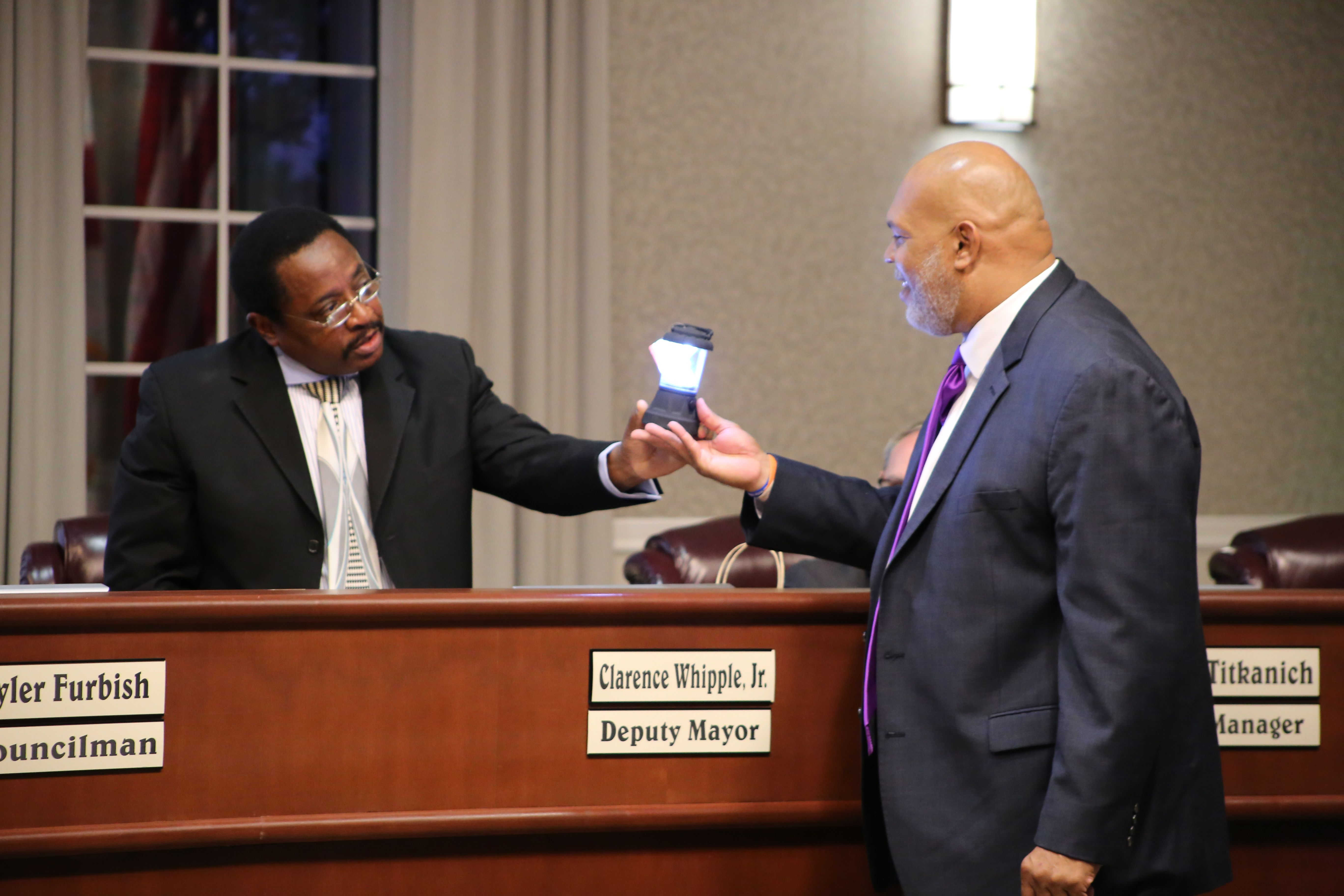 Passing of the torch from Councilman Whipple to Councilman