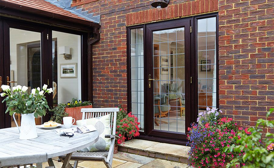 Dark brown woodgrain upvc back door decorative leaded glass we love this pvcu back door with glass detail and casement windows an elegant back door to open on to a beautiful patio garden planetlyrics Images