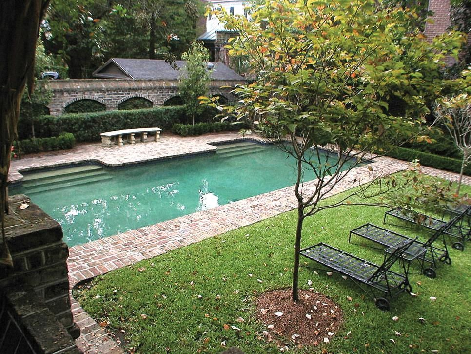 Brick pavers surround a gorgeous rectangle pool in this for Swimming pool surrounds design
