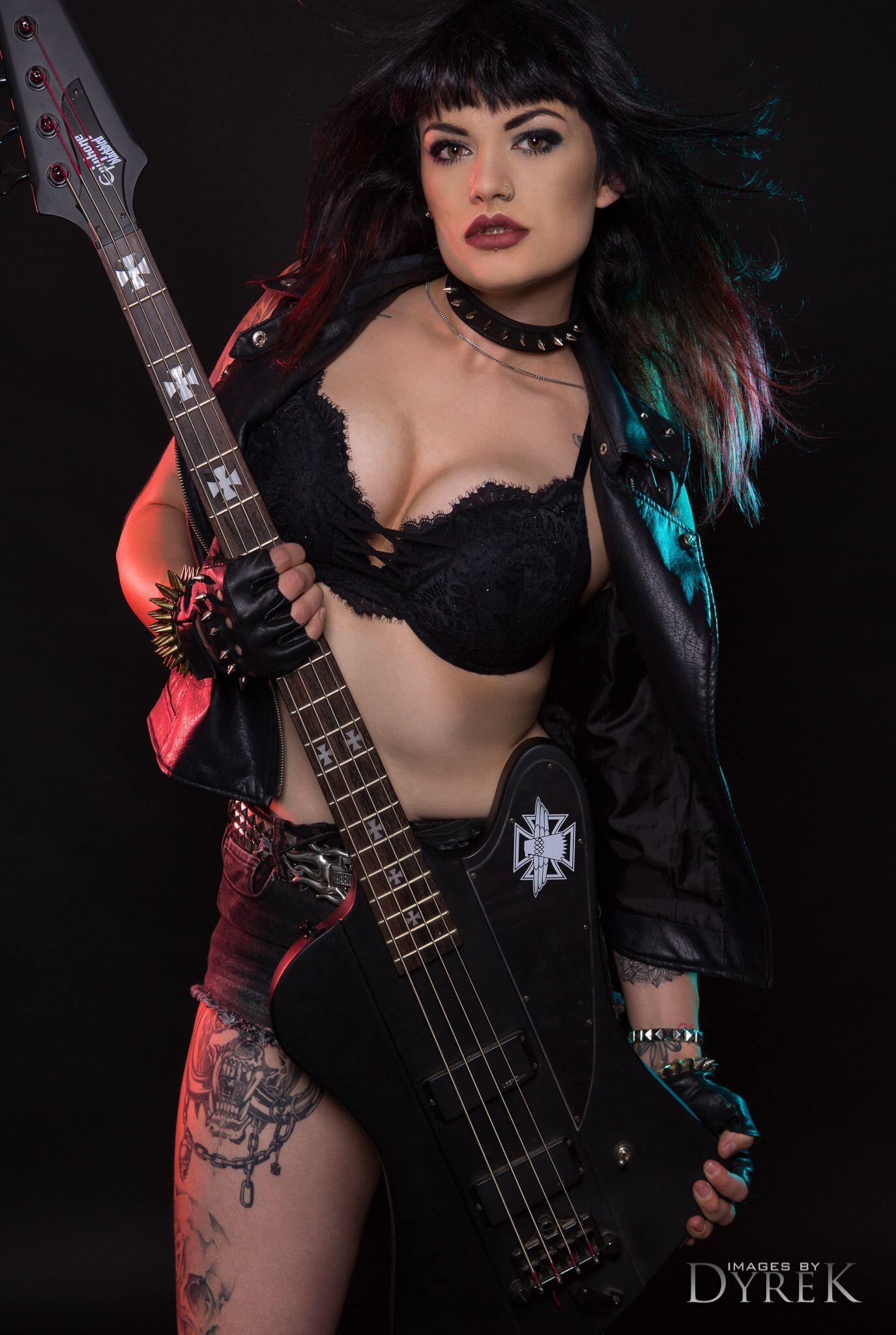camera-busty-metal-guitar-chick
