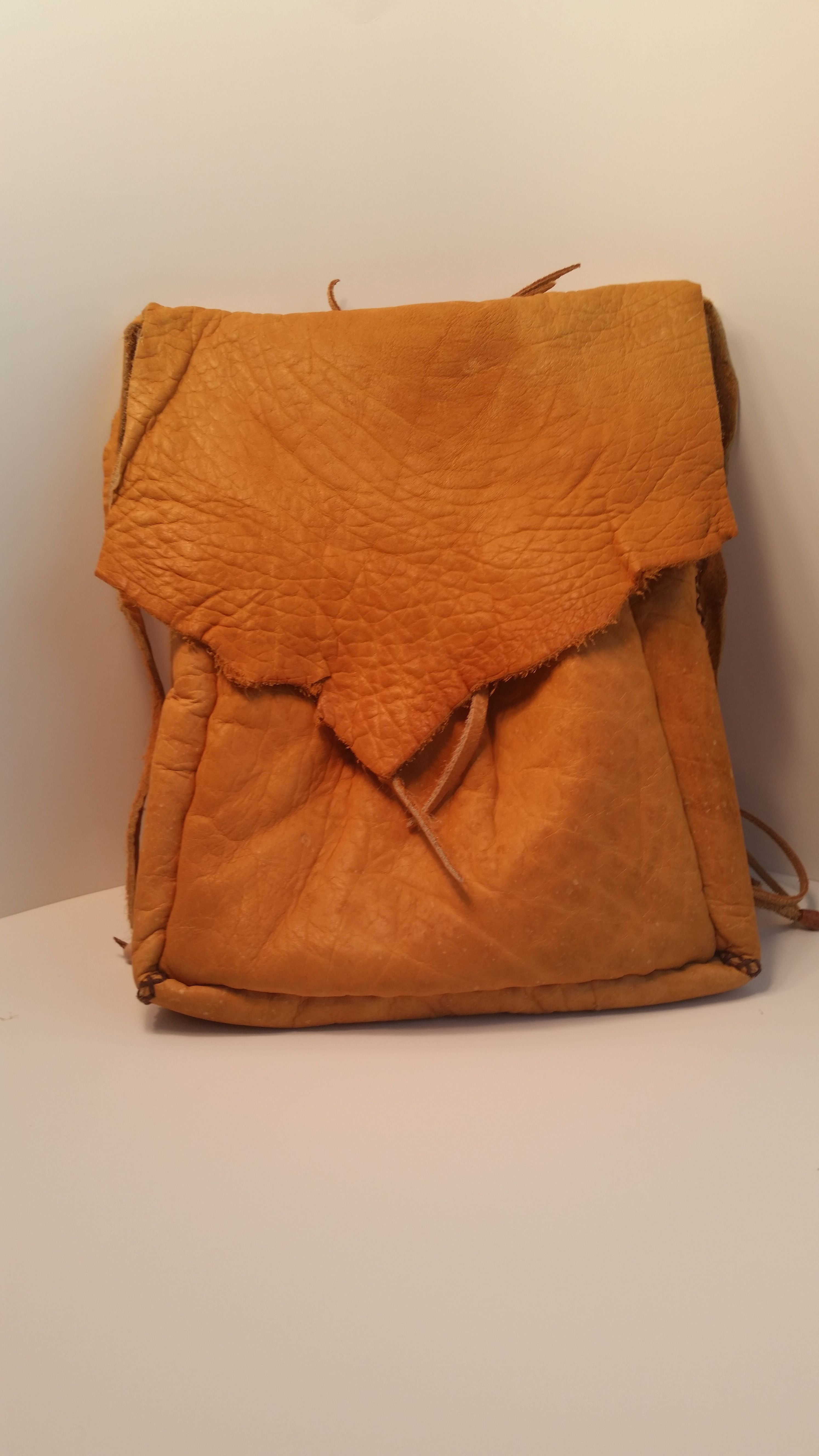 Deer skin backpack, with turquoise, bone and agate beads. Wood and leather suede straps. Handmade with love.