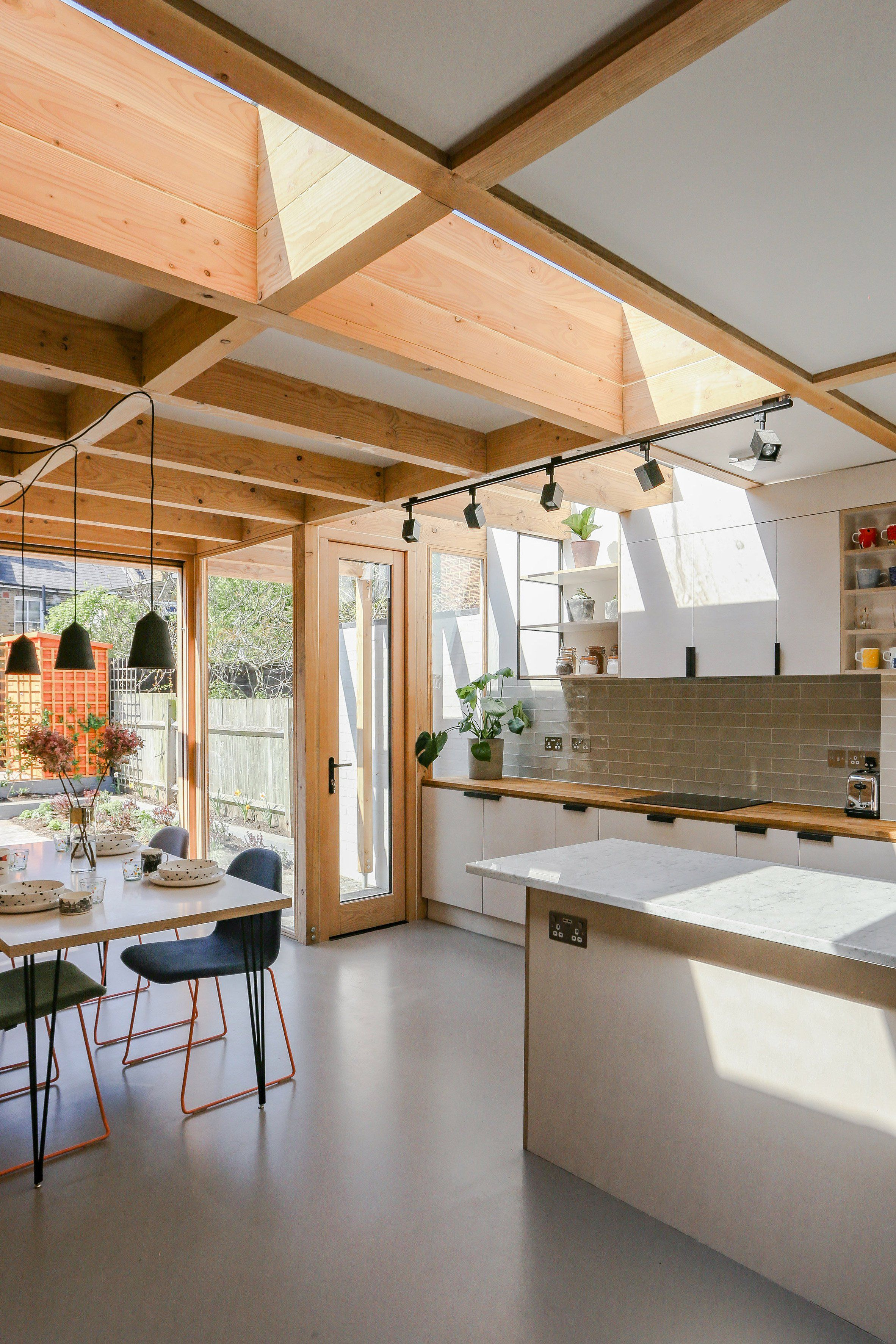 Timber portals frame large windows and skylights in this extension ...