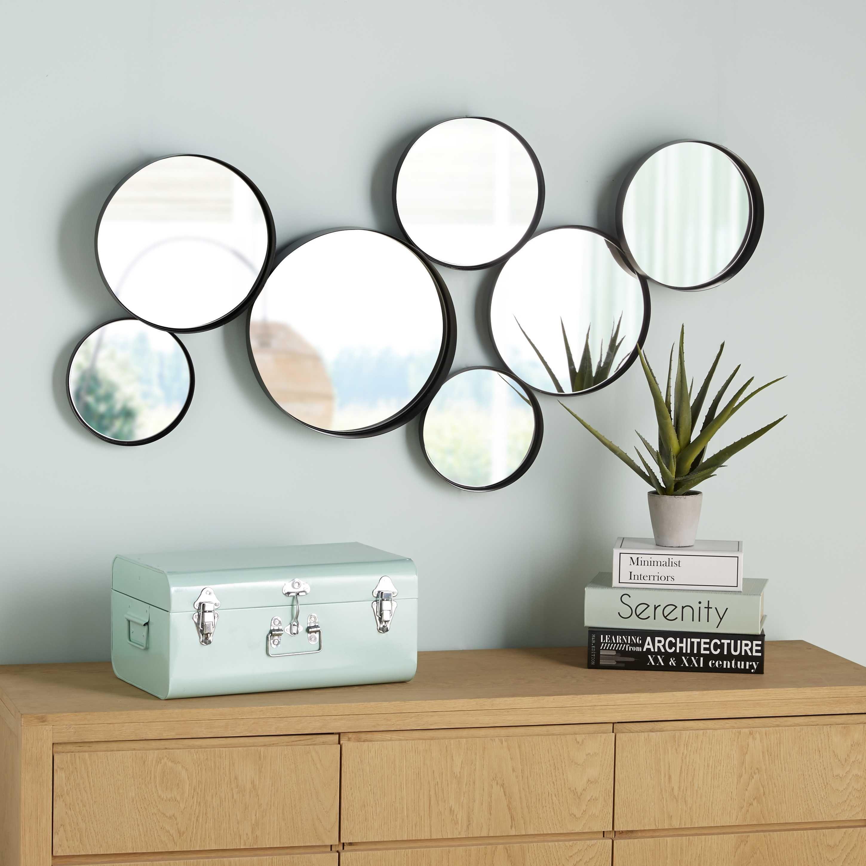 Espejos redondos de metal negro 121x66 cm espejos for Espejos circulares decorativos