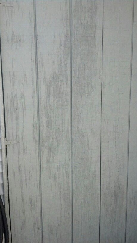 Weathered gray siding on beach shed